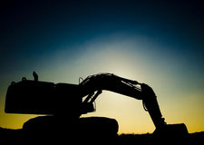 挖掘机的日落 库存照片