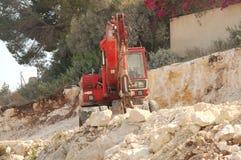 挖掘机的红色 图库摄影