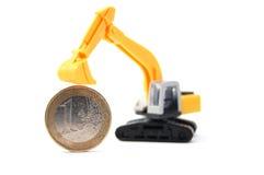 挖掘机的货币 免版税库存照片