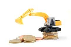 挖掘机的货币 免版税库存图片