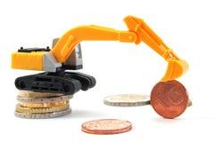 挖掘机的货币 图库摄影