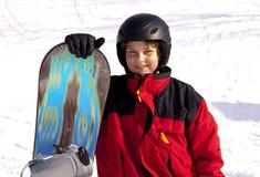 挡雪板年轻人 免版税库存照片
