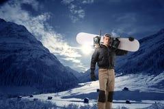 挡雪板年轻人 免版税库存图片