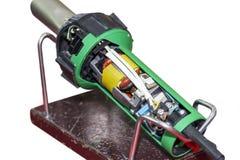 挤压机塑料焊接器的接近的横断面在白色背景工业修理和维护的隔绝的 免版税库存照片