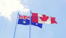 挥动反对蓝天的两面旗子 免版税库存图片