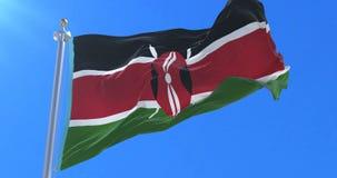 挥动在慢的风的肯尼亚的旗子与蓝天,圈 股票视频