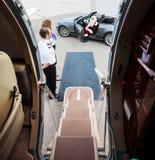 挥动在有飞行员的敞篷车的圣诞老人和 图库摄影