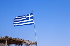 挥动在海滩的希腊的旗子 库存图片
