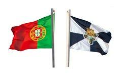 挥动在白色隔绝的旗杆的风的葡萄牙和里斯本旗子  免版税库存照片