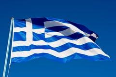 挥动在风的希腊的旗子 库存照片