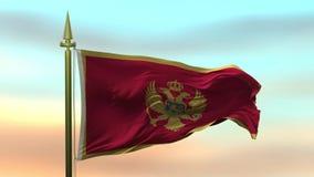 挥动在风的黑山的国旗反对日落天空背景慢动作无缝的圈 库存例证
