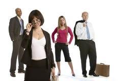 挥动妇女的企业同事 免版税库存图片