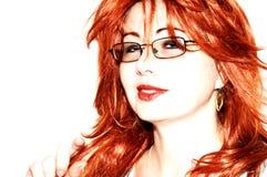 挥动的头发的红色妇女 免版税库存照片