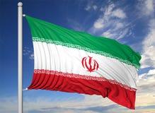 挥动的旗子在旗杆伊朗  免版税库存照片