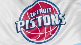 挥动的旗子特写镜头与底特律活塞美国职篮蓝球队商标,无缝的圈,蓝色背景的 社论 皇族释放例证