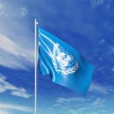 挥动的联合国旗子 免版税库存照片