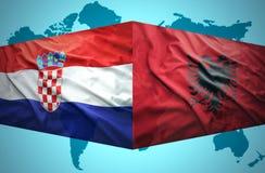 挥动阿尔巴尼亚和克罗地亚旗子 免版税库存照片