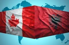 挥动阿尔巴尼亚和加拿大旗子 图库摄影
