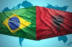 挥动阿尔巴尼亚和巴西旗子 库存图片