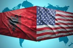挥动阿尔巴尼亚和美国国旗 库存照片