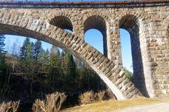 挪威石曲拱桥梁 库存照片