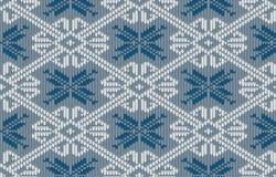 挪威语编织了与雪花的样式在葡萄酒蓝色颜色 图库摄影