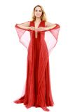 振翼的红色礼服的新秀丽妇女 免版税库存照片