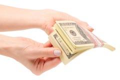 捆绑金钱美元在手上 图库摄影