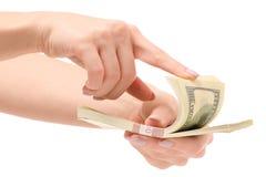 捆绑金钱美元在手上 免版税库存图片