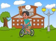 捉住与自行车的小男孩一只蝴蝶在他的学校动画片前面 免版税库存照片