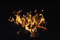 捉住在火焰 库存照片