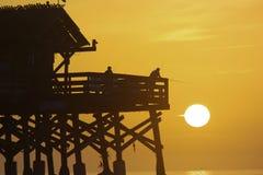 捉住太阳的渔夫 免版税库存照片