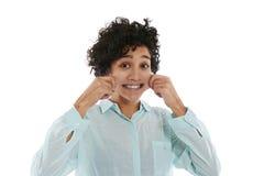 捏面颊和微笑的妇女画象 免版税库存图片
