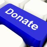 捐赠在蓝色显示的慈善的计算机键盘 库存照片