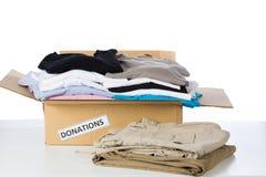 给捐赠箱子穿衣 图库摄影