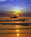 捕鱼印度日落 免版税库存照片