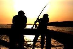 捕鱼友谊 库存照片