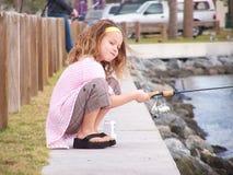 捕鱼女孩一点 免版税库存图片