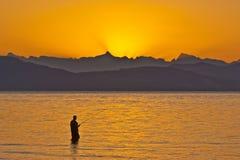 捕鱼日出 图库摄影