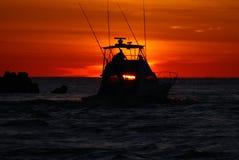 捕鱼日出 库存照片