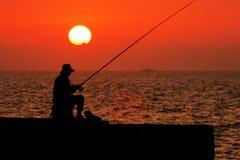 捕鱼日落 库存照片