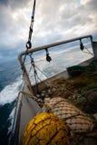 捕鱼网和装配在一艘捕鱼船的船尾 库存照片