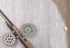 捕鱼网和钓鱼竿 免版税库存照片