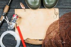 捕鱼装置-渔、渔、勾子和诱饵,老板料o 图库摄影