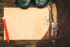 捕鱼装置-渔、渔、勾子和诱饵,老板料o 免版税库存照片