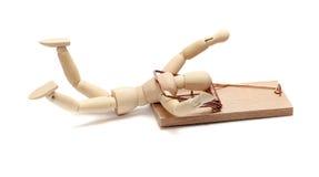 捕鼠器被获取的木玩偶 免版税库存图片