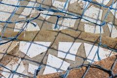 损坏的水池网 免版税库存图片