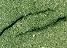损坏的绿色定了调子沥青表面 免版税图库摄影