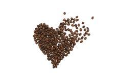 捣毁的心脏由咖啡豆制成在白色背景 免版税库存照片
