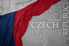 捷克共和国挥动的五颜六色的国旗在灰色背景的与关于国家的重要词 免版税库存图片